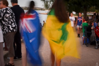 patiently waiting for people to walk past with flags. Lucky to get two girls with two different Aust. flags
